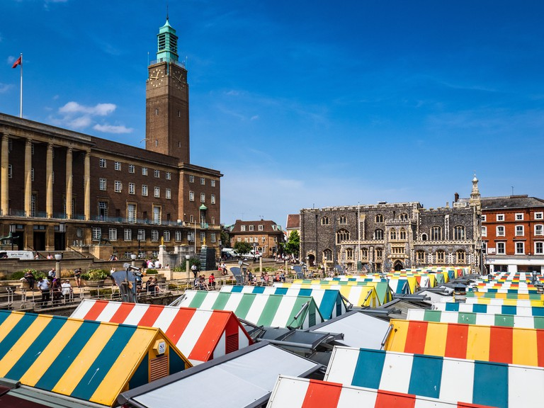Norwich Tourism - Norwich Market with Norwich City Hall and Guildhall in the background. Norwich City Centre.