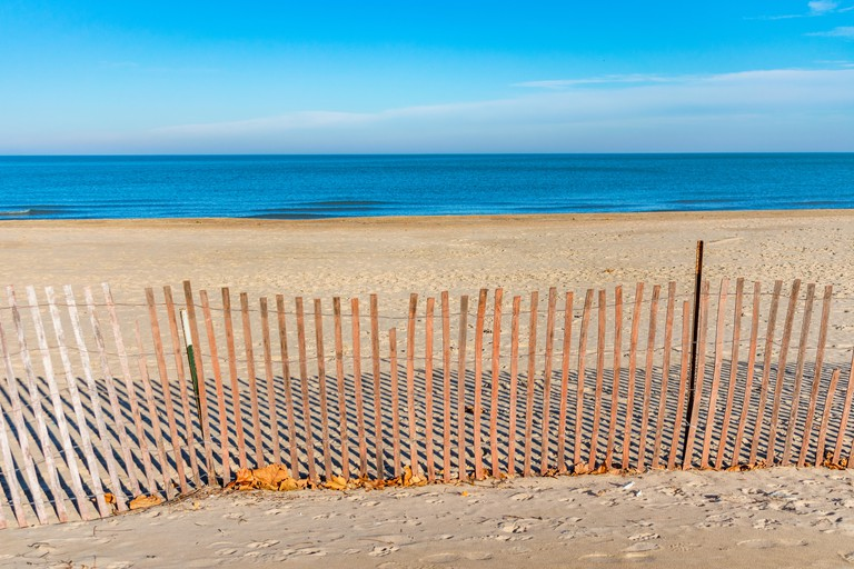 Fence at Foster Beach in Chicago with Lake Michigan