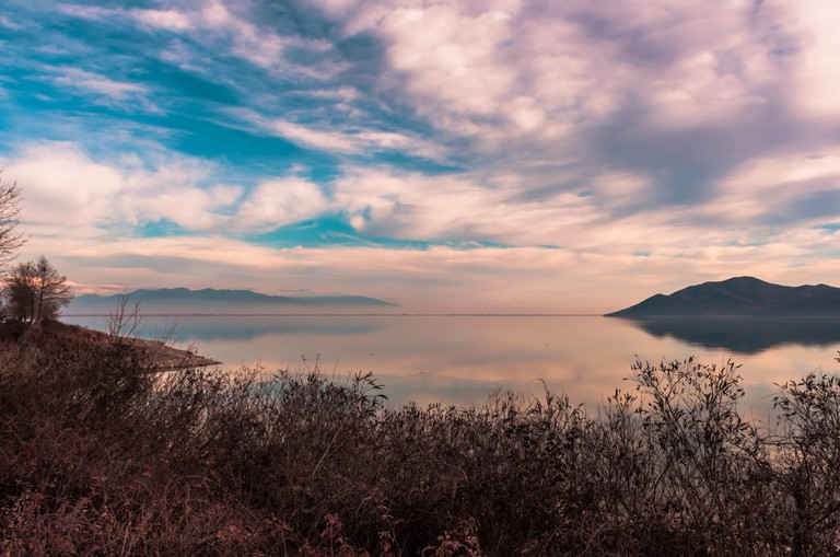View of lake Kerkini and Beles mountain in Serres. Beautiful lake reflections at sunset time.