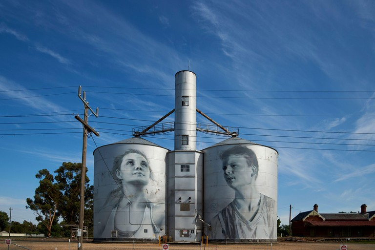 Silo Art Trail mural, painted by Russian artist Julia Volchkova. It depicts local youth. In Rupanyup, Victoria, Australia.