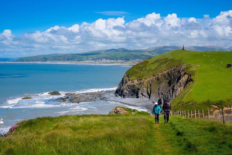 Walkers on the Wales Coast Path near Borth, Ceredigion, Wales, UK