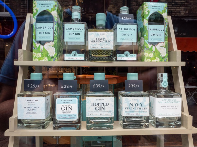 The window display and bottles of gin in the window of the  Cambridge Gin Laboratory shop in Green Street Cambridge UK