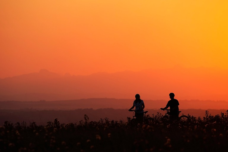 Woman and man riding bicycle in Nose Hill natural environment park