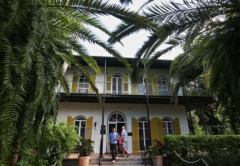 Key West, Florida, USA. 19th Dec, 2013. SCOTT KEELER | Times. Visitors exit the Ernest Hemingway Home & Museum at 907 Whitehead Street in Key west, December 2013. Designated a U.S. National Historic Landmark in 1968, the home was the famous author's resid