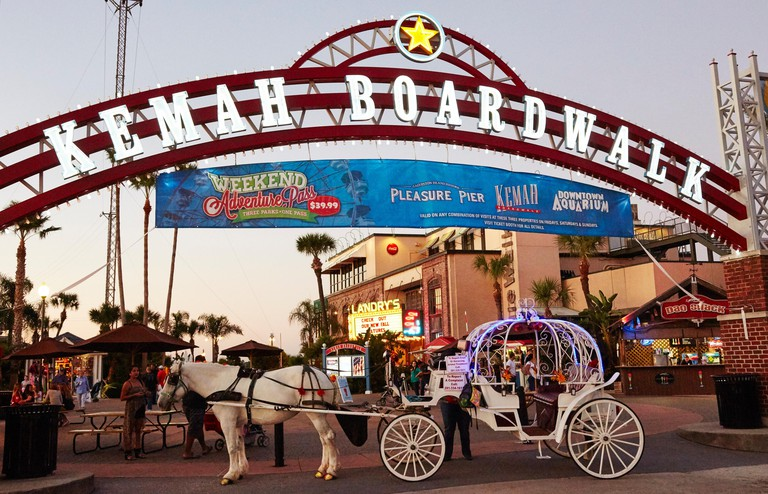 Horse and carriage at the entrance to Kemah Boardwalk, Houston, Texas, USA