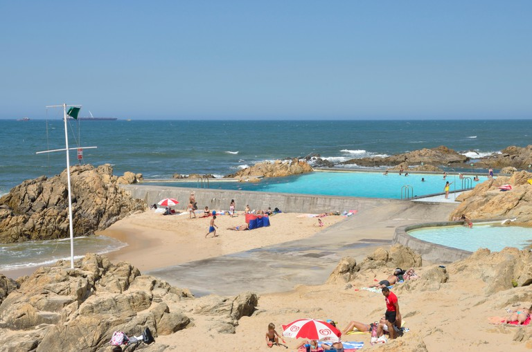People sunbathing at the Leça Da Palmeira Pools in the north of the city of Matosinhos, Portugal