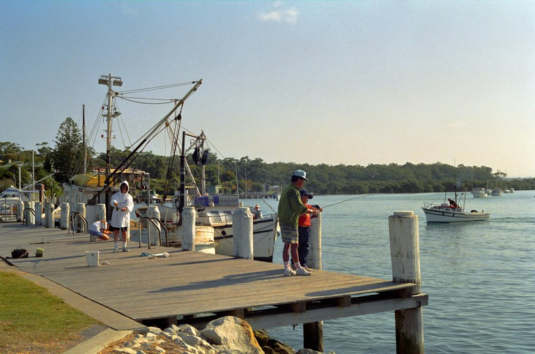The town quay on Currambene Creek, Huskisson, New South Wales, Australia. Image shot 1993. Exact date unknown.