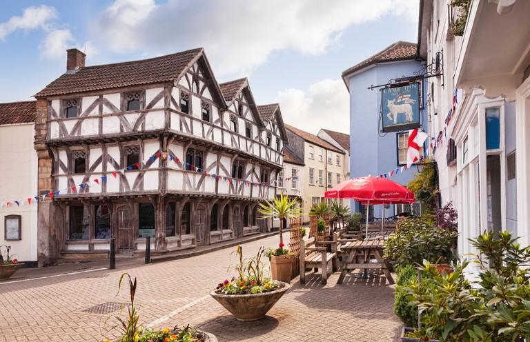 The medieval square in Axbridge, Somerset, England, UK. The half timbered building is King John's Hunting Lodge, now the museum.