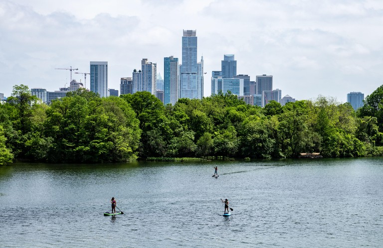 Beautiful day in Austin, Texas with Paddle Boarders enjoying Lady Bird Lake
