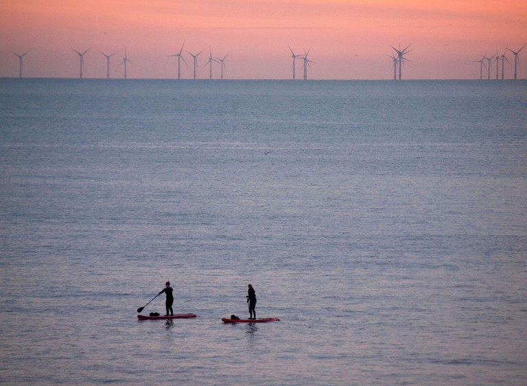 Paddle boarding in Brighton as the sun goes down