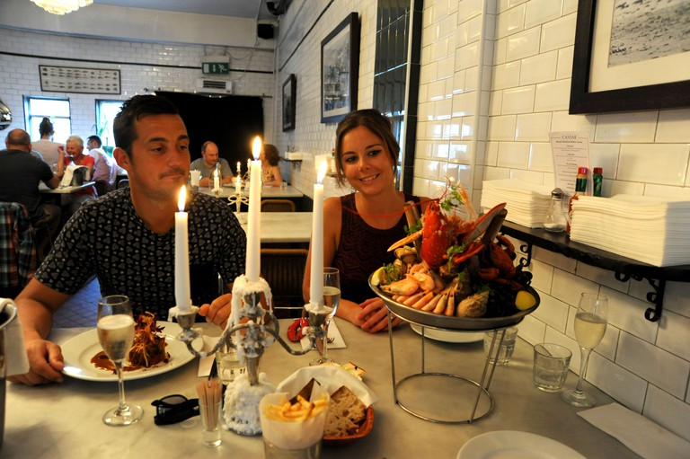 Young couple eating lobster shellfish platter at Riddle and Finns Fish Restaurant in The Lanes Brighton. Image shot 06/2014. Exact date unknown.