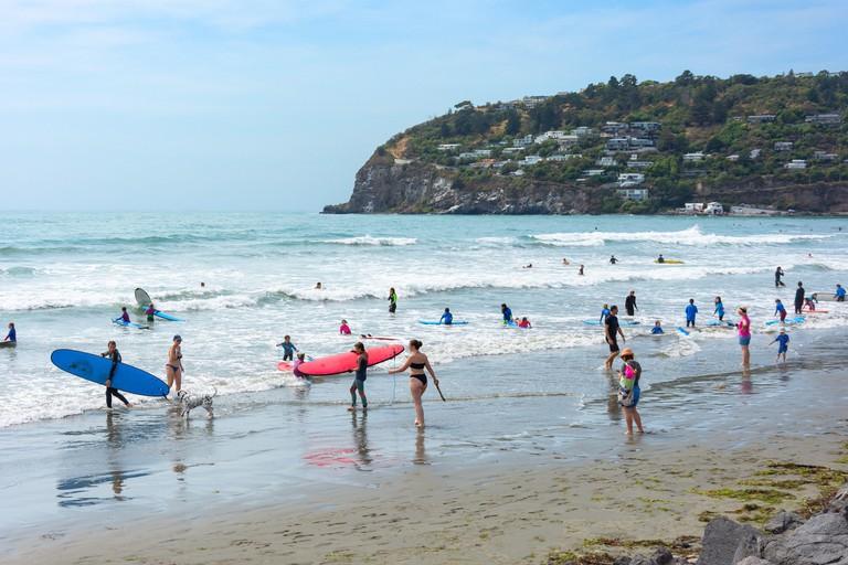 Children surfing on Scarborough Beach, Scarborough, Christchurch, Canterbury Region, New Zealand