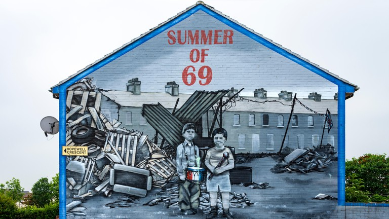 'Summer of 69' loyalist wall mural on the Shankill estate, Belfast, County Antrim, Northern Ireland, UK
