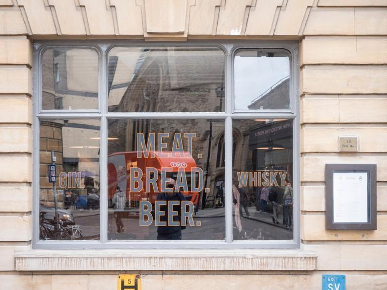 The window of the Pint Shop meat bread and beer restaurant Wheeler Street Cambridge UK