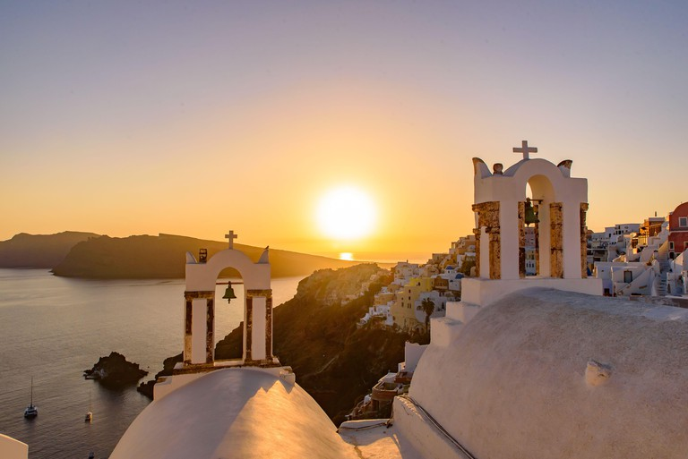 Bell tower with warm sunset light in Oia, Santorini, Greece