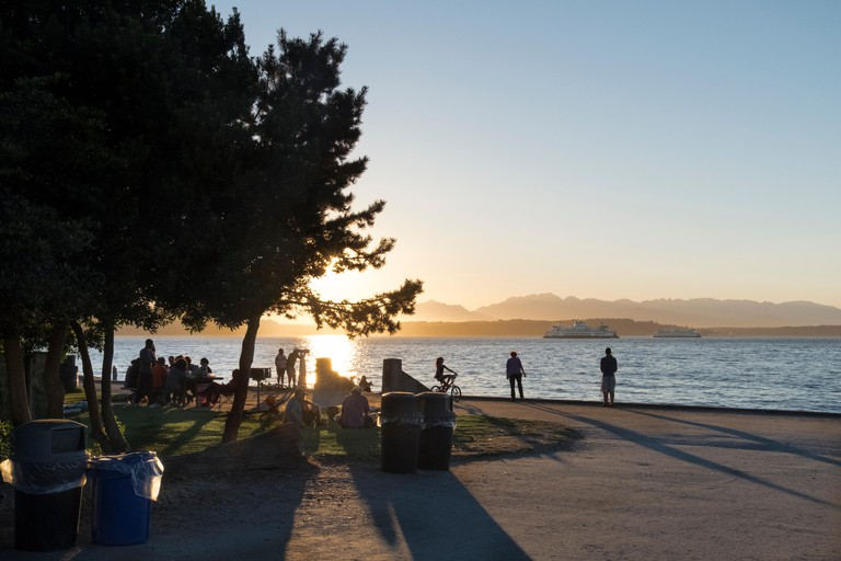 View of Puget Sound and Olympc Mountains from Alki beach, Seattle, Washington, USA