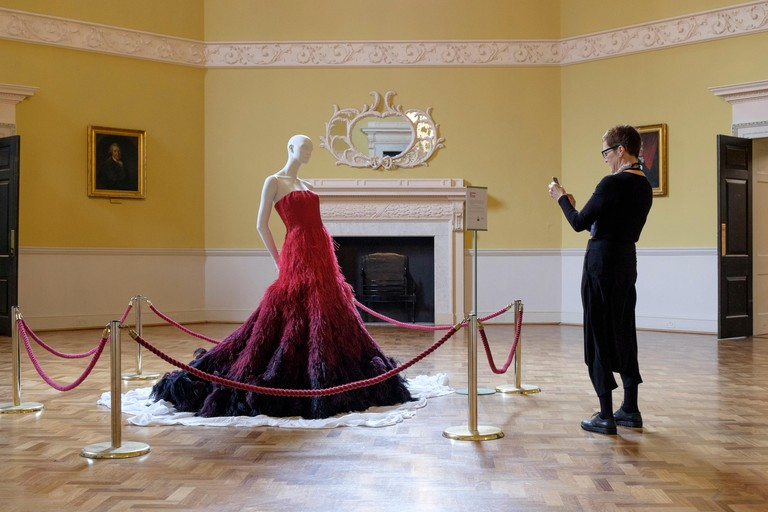 Bath, UK, 18th April, 2016. The GREAT dress a couture dress designed by Nicholas Oakwell and made especially for the government's GREAT campaign is pictured being unveiled by the curator of the Fashion Museum Rosemary Harden in the Octagon at the Assembly