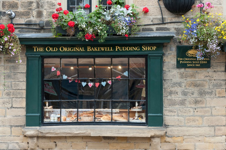 The window of the Old Original Bakewell Pudding Shop Bakewell Peak District Derbyshire UK