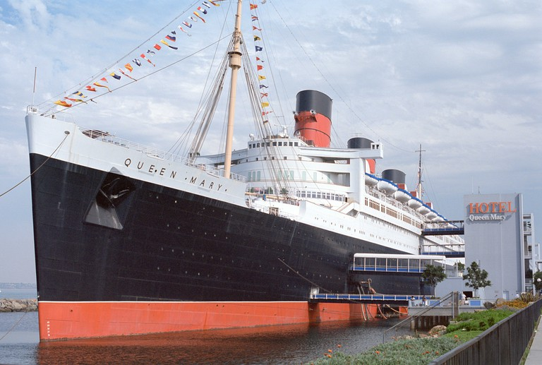 Front bow view of the Queen Mary permanently berthed at Long Beach California where she is a floating Hotel and museum ship.. Image shot 1991. Exact date unknown.