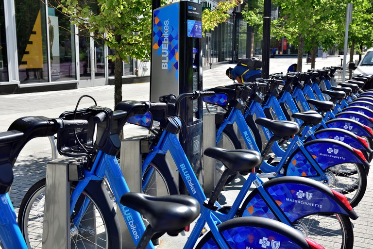 Row of Boston Bluebikes in docking station, public bike share system in Boston, Cambridge and Somerville, Massachusetts, USA