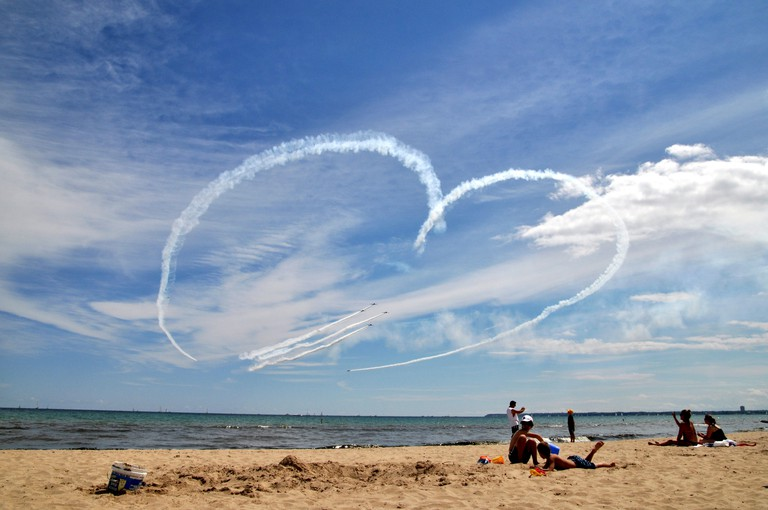 Airplanes draw heart in the sky and fighter jets fly through it, Milwaukee Air Show, Bradford Beach, Milwaukee, Wisconsin, USA