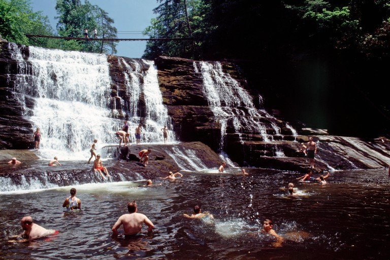 Families enjoying the cool water cascades of Cane Creek, Fall Creek Falls State Park,Tennessee