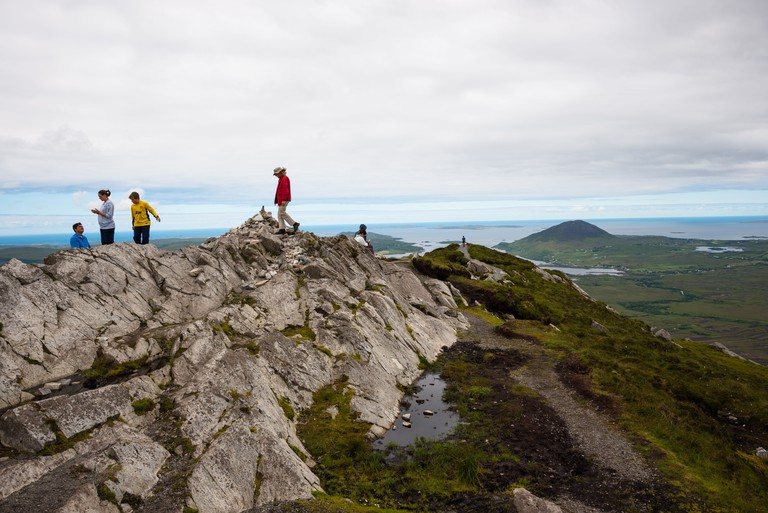 Walkers on the summit of Diamond Hill, Connemara National Park, County Galway, Ireland