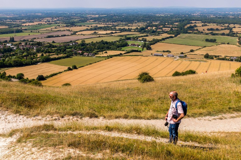 Photographer On The South Downs Near Devils Dyke Outside Of Brighton, East Sussex, England