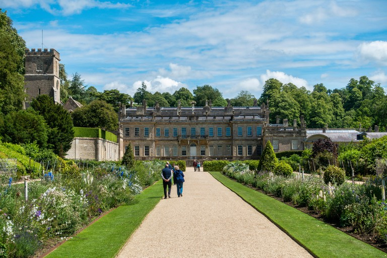 A view from the road of the gardens and house at Dyrham Park, a National Trust Property in Gloucestershire, England , UK