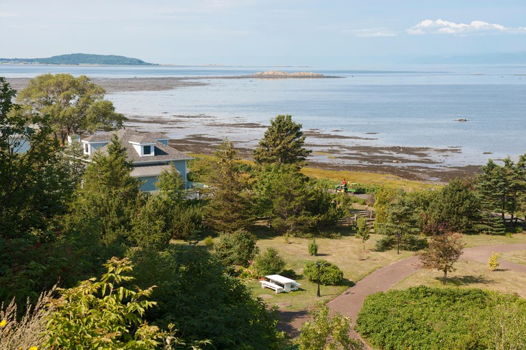 House on the shores of the St Lawrence river in Kamouraska, Bas-Saint-Laurent region of Quebec, Canada.