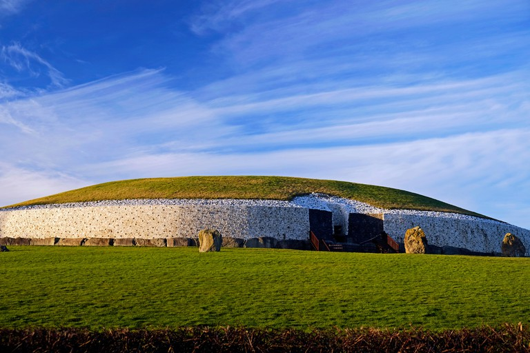 Newgrange Neolithic Passage Tomb in Co. Meath Ireland,  with Cirros clouds. Winter Solstice sun penetrates to the inner chamber