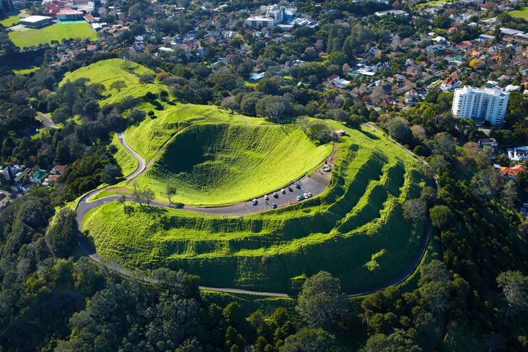 Volcanic crater, Mt Eden, ( historic Maori pa site ), Auckland, North Island, New Zealand - aerial
