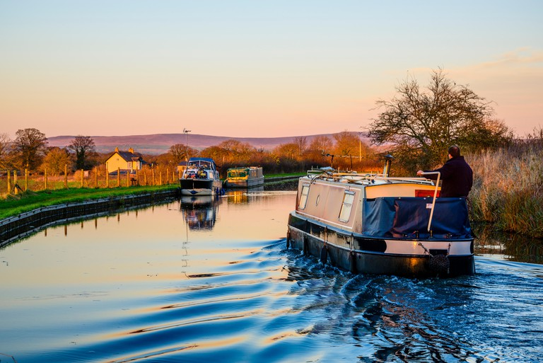 Narrowboat on a winter evening on the Lancaster Canal near Garstang Lancashire UK
