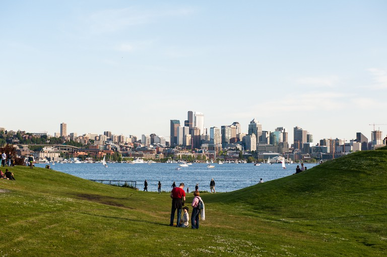 Families and friends gather at Gas Works Park which overlooks Lake Union and the Seattle Skyline.