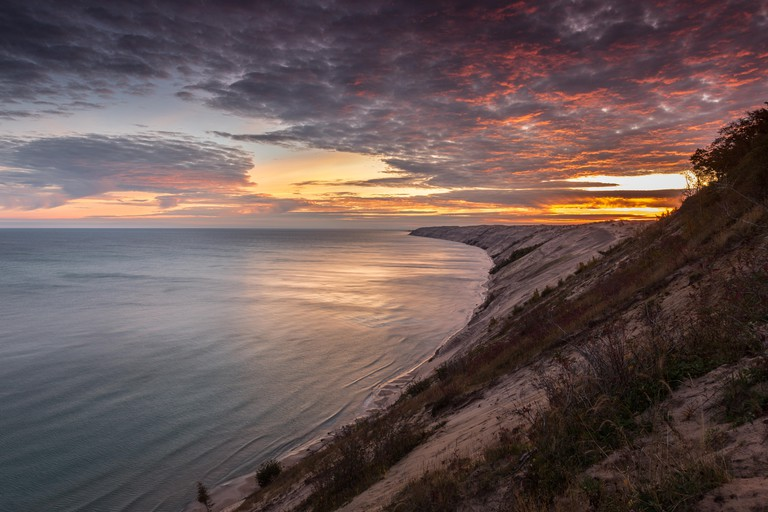 A spectacular sunrise over Grand Sable Dunes near Grand Marais, Michigan. The Log Slide Overlook is part of Pictured Rocks.