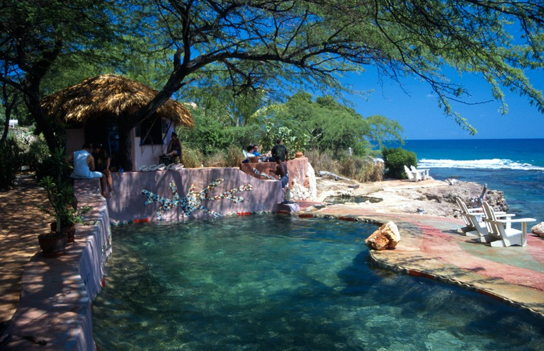 Pool and bar area overlooking the sea Jakes Island Outpost Treasure Beach south coast Jamaica West Indies
