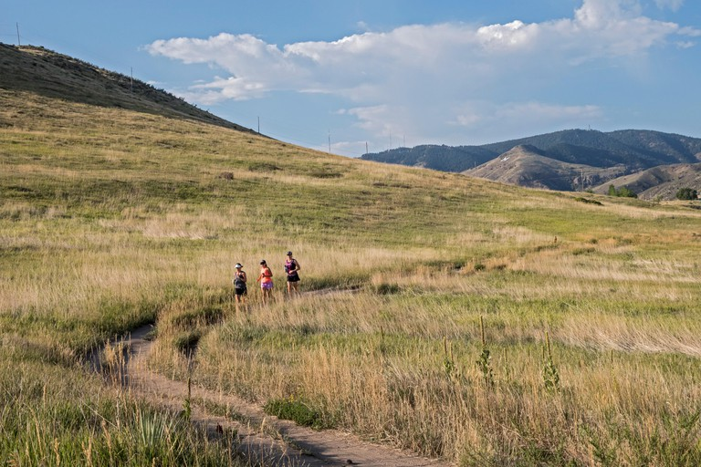 Golden, Colorado - Runners in North Table Mountain Park, a mesa overlooking Denver.
