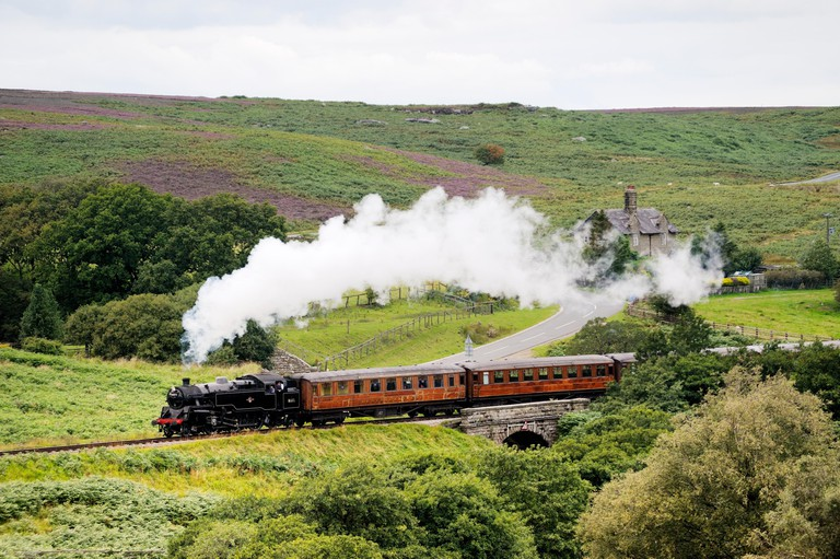 North Yorkshire Moors Railway. Vintage steam locomotive railway engine No.80072 pulls train south from Goathland, England, UK