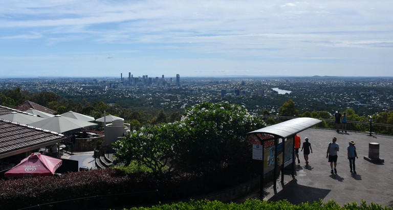 Brisbane, Australia - Dec 30, 2017. People at Mt-Coot-Tha Lookout. The panoramic view of Brisbane, Queensland in the background.