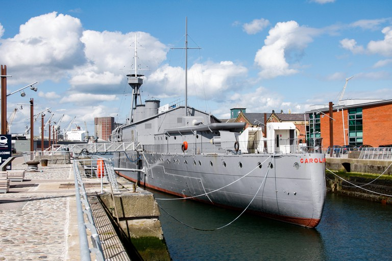 Stern view of HMS Caroline, a restored World War 1 battleship moored in Titanic Quarter, Belfast and the last survivor of the Battle of Jutland
