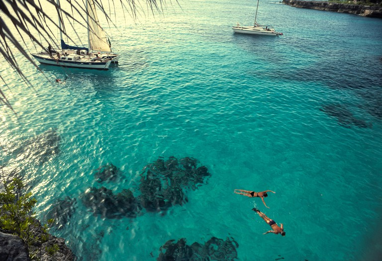 Couple snorkeling off the cliffs of Negril, Jamaica