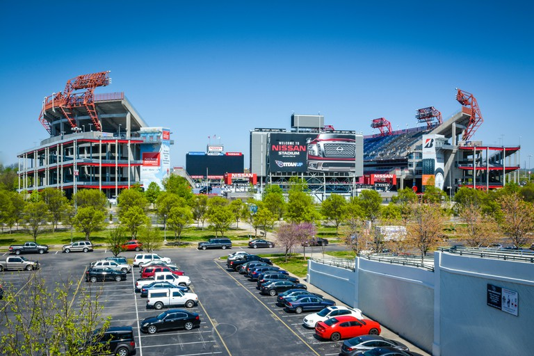 View from parking lot serving downtown Nashville and the NFL team Titans' Nissan stadium on the riverfront in Music City USA, TN