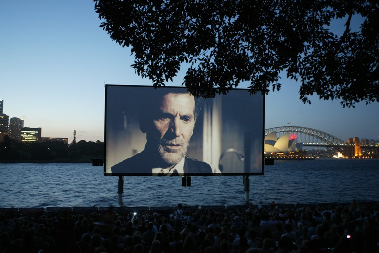 Open Air Cinema near Mrs Macquarie's Chair in Sydney. The screen begins to rise