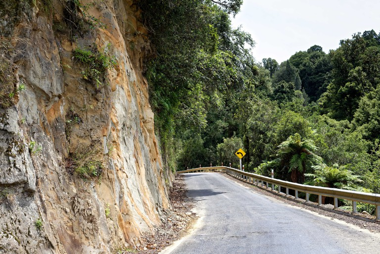 The Forgotten World Highway through farmland in Taranaki