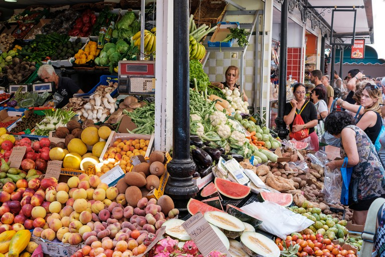 Santa Cruz de Tenerife, Canary Islands, Spain - September 2018: People buying fruits and vegetables at food market Municipal Market Our Lady of Africa