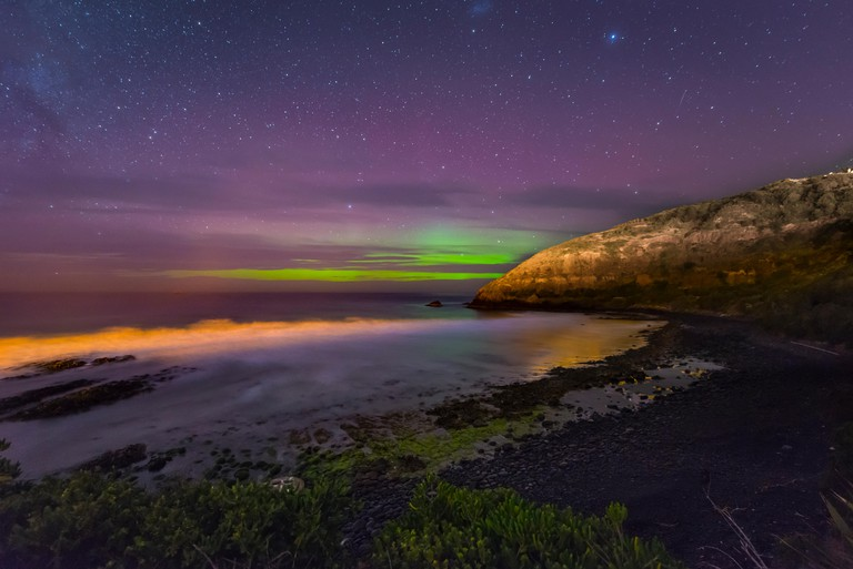 Southern lights, aurora australis over the sea, sand dunes, Second Beach, Dunedin, Otago, Southland, New Zealand