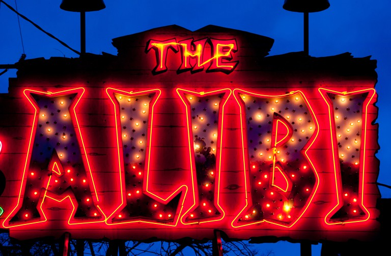 Neon sign for the ALIBI restaurant and bar, an icon of Portland, Oregon