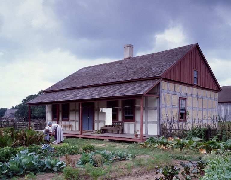 Historic interpreter harvesting radishes at Old World Wisconsin, the state historical society's outdoor museum in Eagle, Wisconsin
