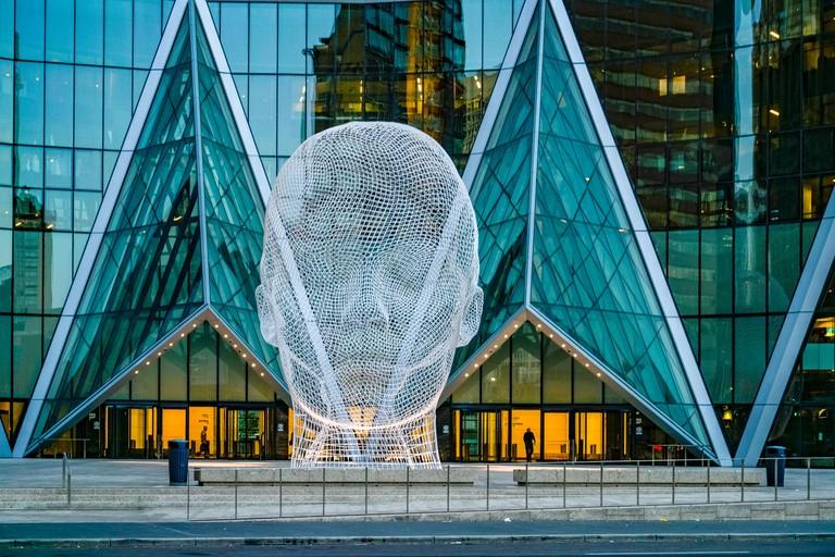 Wonderland sculpture by Jaume Plensa. Bow Tower, Calgary, Alberta, Canada