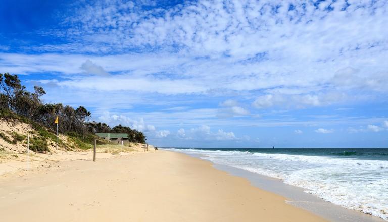 Ocean beach during run out tide on a sunny day in Woorim, Bribie Island, Australia